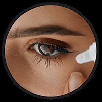 Woman using eye drops for Dry Eyes