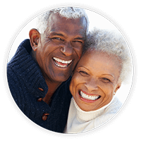 Older couple with diabetic retinopathy smiling