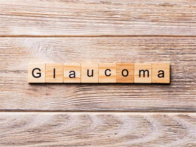 Wood letter tiles spelling out Glaucoma